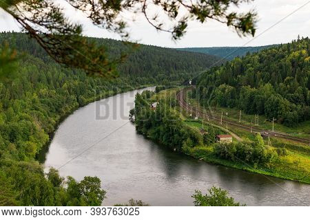 Kungur, Perm Region, Russia - August, 8 2020: Railway Road Bends Along River Chusovaya View From Erm