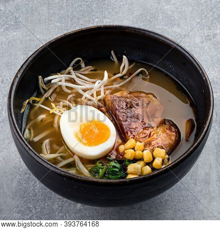 Traditional Japanese Soup Ramen With Meat Broth, Asian Udon Noodles, Seaweed, Eggs And Ginger On Dar
