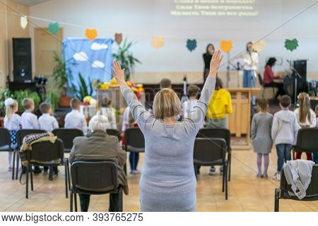 People Praying In A Church. Soft Focus Of Christian People Group Raise Hands Up Worship God Jesus Ch