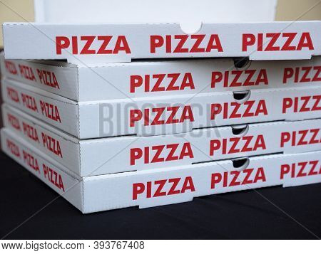 Stack Of White Pizza Boxes With Red Letters. Take-away Concept