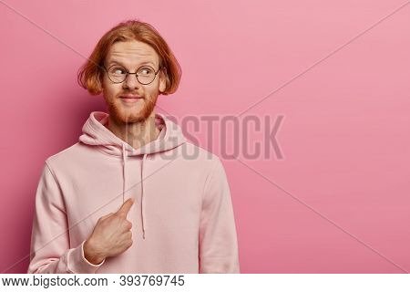 Pleased Redhead Man With Bob Hairstyle And Ginger Hair, Points At Himself And Looks In Wonder Aside,