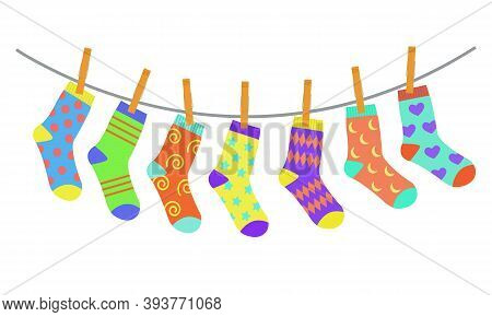 Set Of Colorful Bright Children Socks Drying On The Clothesline. Vector Illustration In Flat Style.