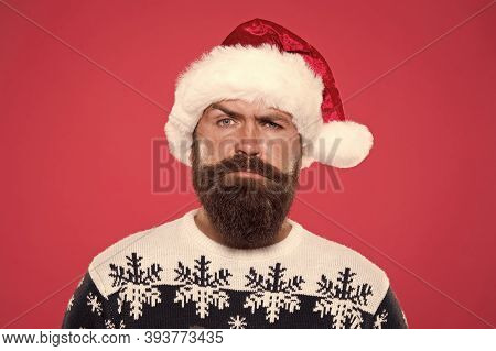Serious Bearded Man Santa Hat. Brutal Hipster Favorite Sweater Red Background. Winter Holiday Fun. S