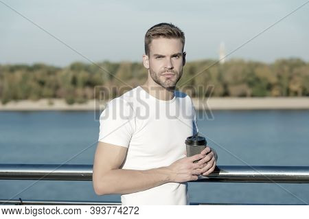 Cup Of Sunshine Every Morning Helps To Start New Day. Young Guy Drink Takeaway Coffee In Morning. En