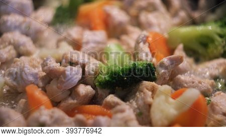 Stir Fry Chicken With Vegetables, Healthy Food And Diet. Concept. Close Up Of Frying Green Broccoli,
