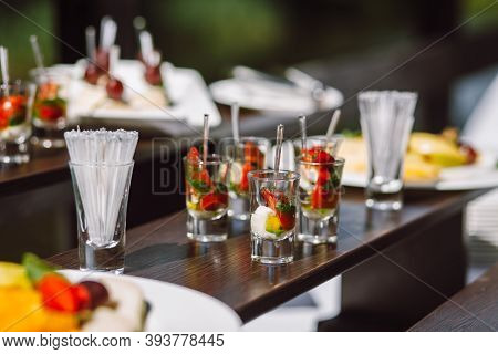 Cold Appetizer At A Wedding Banquet, Cherry Tomatoes With Mozzarella Cheese And Pesto In A Glass. Cu