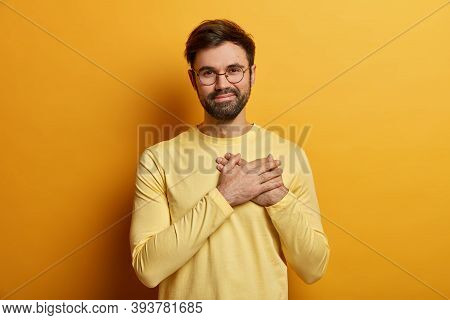 Handsome Bearded Guy Keeps Hands On Heart, Expresses Sincere Emotions, Appreciates Help And Heartwar