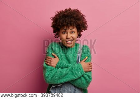 Dark Skinned Curly Woman Feels Very Cold, Crosses Arms Over Chest, Trembles From Feeling Freezing, S