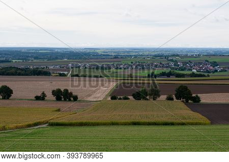 View Over Rural Landscape With Fields And Villages In The Valley Of River Danube With The Mountains