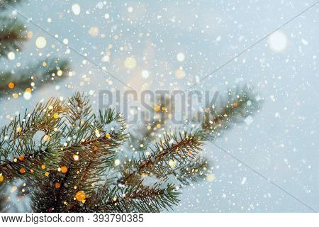 Closeup Of Christmas Tree With Sparkling Light, Snowflake. Christmas And New Year Holiday Background