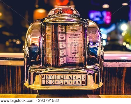 11/9/2020: A 1960s Retro Looking Mini Jukebox Radio On A Table Top At Johnny Rockets In Hoboken, Nj.