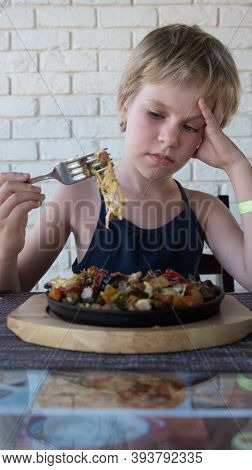 The Child Looks At The Roast. There Is No Appetite. The Girl Doesnt Want To Eat. The Concept Of Lack