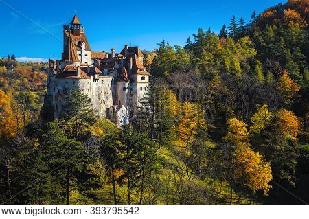 Majestic Dracula Castle On The Hill In The Autumn Forest, Bran, Transylvania, Romania, Europe