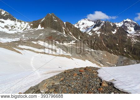Mountain Snow Panorama And Blue Sky In Tyrol Alps, Austria
