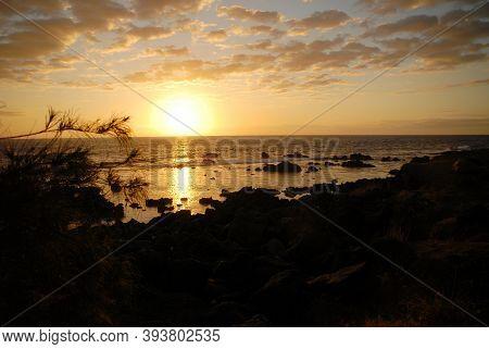 A Colorful Ocean Beach Sunrise With Deep Blue Sky