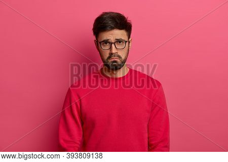 Dejected Sad Man With Thick Beard, Has Unlucky Day, Faces Problems In Life, Looks Desperately And Gl