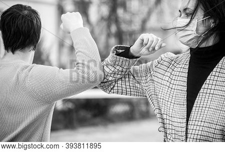 Elbows Bump. Couple Greeting With Elbows. Friends In Protective Medical Mask On His Face Greet Their