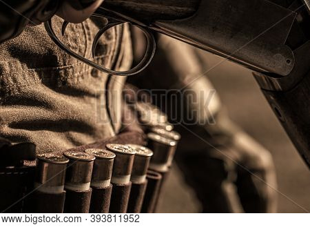 Ammunition Bullet. Male Hunter Ready To Hunt With Hunting Rifle. Close Up Ammunition. Ammunition Wit