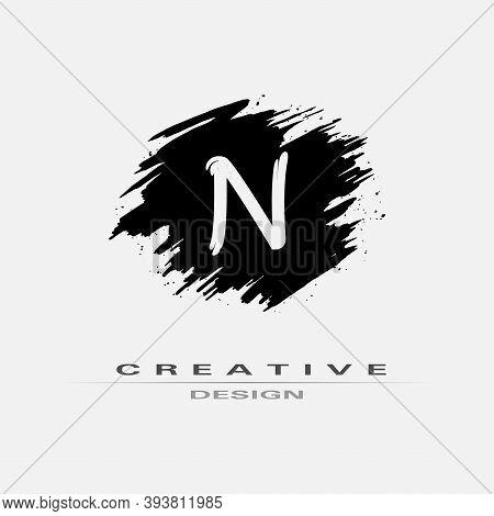 Letter N Logo With Brush Stroke And Splatter Elements. Handwritten Brush Stroke Letter N Logo Design