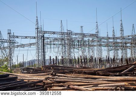 outdoors electrical power station and transformer and wooden poles