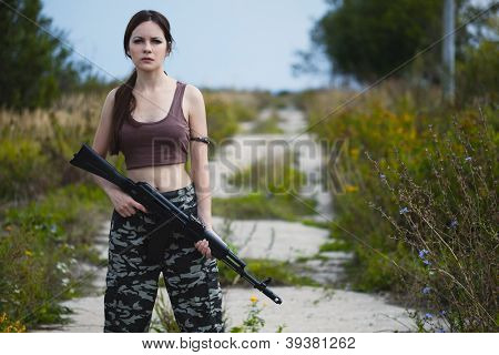 A beautiful military woman with an automatic rifle ak-74