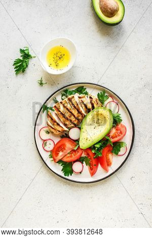 Healthy Lunch With Chicken. Grilled Chicken Fillet And Vegetable Salad With Avocado On White, Top Vi