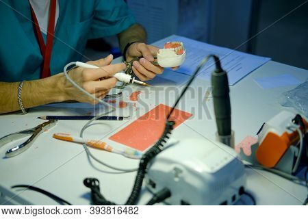 A Dentist Doctor Is Working On Creating Dentures. Tools For Creating An Artificial Jaw On The Prosth
