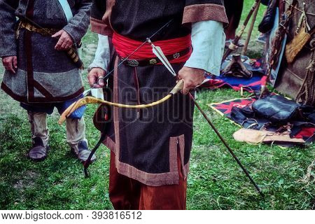 Archer Retro Tribe Stands With A Bow In His Hand. Reconstruction Old Life Of The Nomadic Peoples. Bo