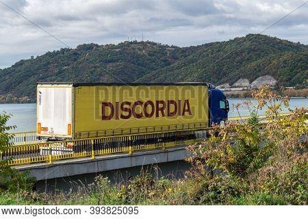 Goods Truck. The Truck Is Crossing A Bridge. It Belongs To