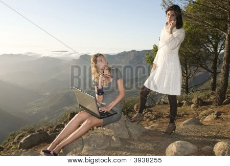 Women Working With Portable Laptop In The Mountain
