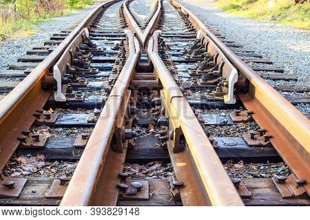 Image Of An Empty Railroad Track Stretching Far Away. Crossing Railway Tracks. Narrow Gauge Railway.