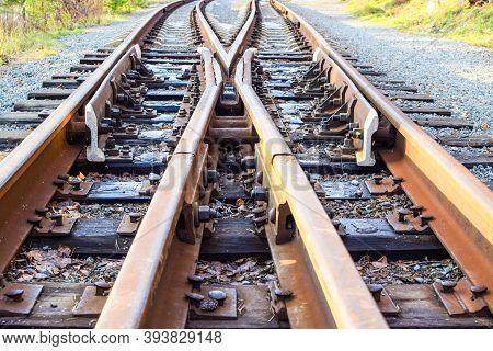 Image Of An Empty Railroad Track Stretching Far Away. Crossing Railway Tracks. Narrow Gauge Railway.