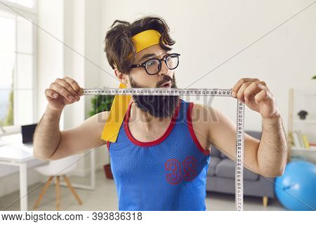 Goofy Fitness Geek Demonstrating Amazing Weight Loss Result After Regular Sport Workouts