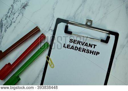 Servant Leadership Write On Paperwork Isolated On Wooden Table.