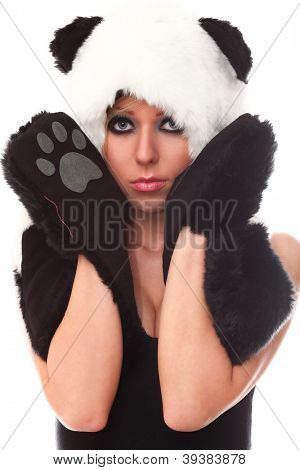 Young and attractive woman in panda suit over a white background