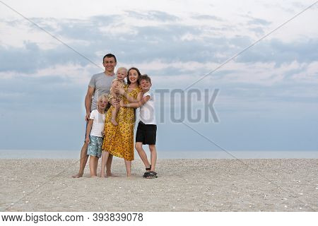 Happy Family At Sea Summer. Mom, Dad And Three Childrenfamily Lifestyle