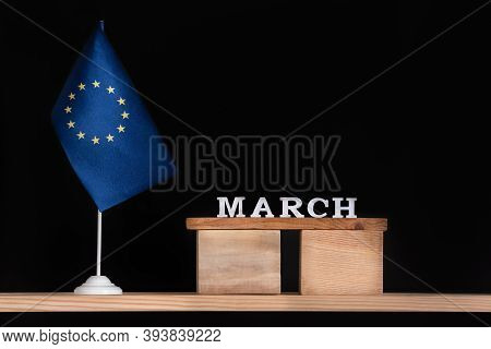 Wooden Calendar Of March With Flag Eu On Black Background. Holidays Of European Union In March.