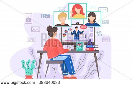 A Girl Sits In Front Of A Computer Monitor At Group Lesson In English With Native Speaker. The Teach
