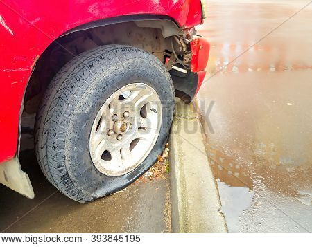 Soft And Selective Focus Of Damaged And Deflated Flat Tires Of An Old Car Parked At The Curb. Concep