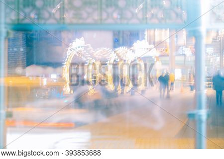 Long Exposure Photography Of City Lights And Unrecognizable People In The City At Night. Night Life