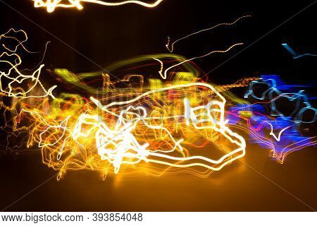 Long Exposure Light Painting Photography, Curvy Lines Of Vibrant Neon Metallic Yellow Blue Colors Ag