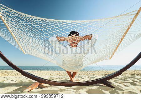 Man Relaxing In Hammock On Beach. Summer Vacation