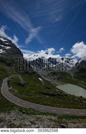 Street And Lake At The Alpine Pass Susten