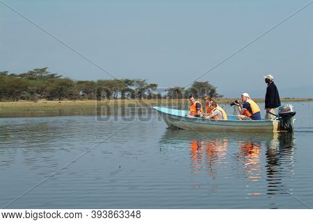 Naivasha, Kenya - August 19, 2010 : Tourists In Boat With Lifejackets Photographing During A Short J