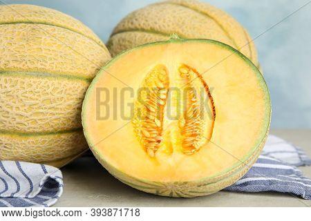 Tasty Fresh Melons On Light Grey Table, Closeup