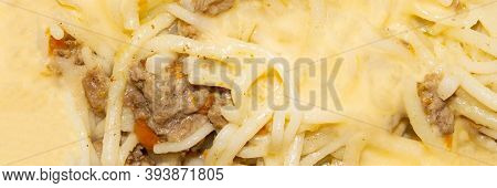 Macaroni With Meat And Melted Cheese.background Vermicelli With Minced Meat And Cheese.
