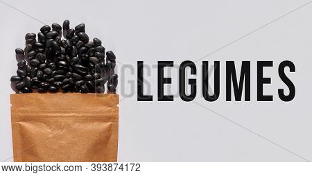 Kraft Paper Pouch Bag With Black Beans Top View With Harsh Shadow White Background. Raw Black Gram V