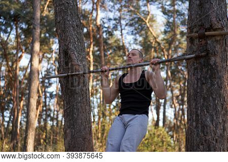 Handsome Caucasian Men Pull-up Outdoor Workout Cross Training Morning Pumping Arm Exercising Sports