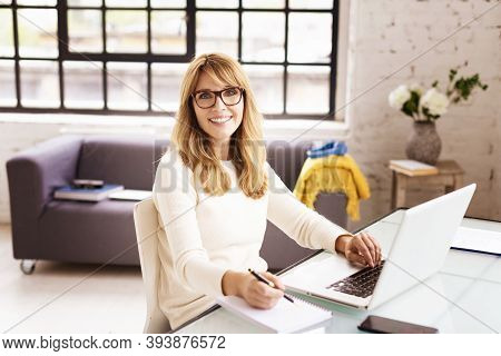 Middle Aged Woman Working From