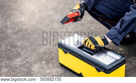 Male Mechanic Or Maintenance Worker Man Holding Red Aluminium Spirit Level Tool Or Bubble Levels Ope